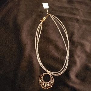 NWT Lia Sophia necklace with circle pendant.